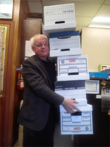 Elwood with a stack of boxes